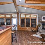 The Denali 861 Prow model by Platinum Cottages  & on display only @ RRC Athens. This amazing cabin has 2 tower dormers, a 8x30 covered front porch, full rock woodburning fireplace, hickory cabinets, barn doors, tile showers and more!
