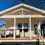 The Brittingham J56F by Oak Creek Homes and on display only @ RRC Athens. This 18' wide is a  2/2 with standard front porch. Shown with SYP trim pkg and extra Clerestory in MBR.