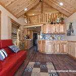 The Timberline 566SLFP model by Platinum Cottages and RRC Athens. This rustic park model cabin is shown with many upgrades including cedar interior pkg with Hickory cabs, a front porch, loft, washer/dryer front loads installed, and more!!