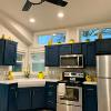 The Premier kitchen with Gale force blue cabinets and a 2 window clerestory window option.